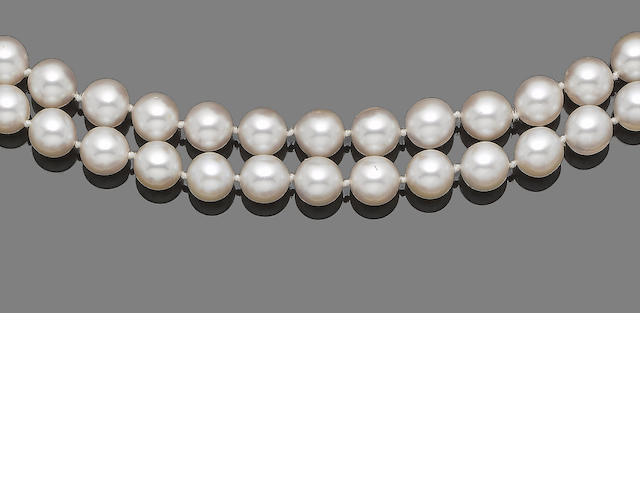 A double-stand cultured pearl necklace with ruby and diamond clasp