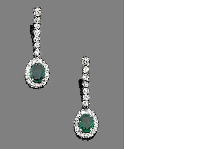 A pair of emerald and diamond pendent earrings