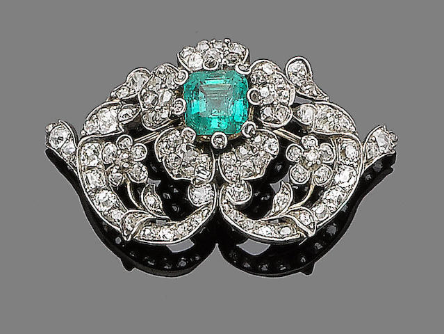 An emerald and diamond brooch,