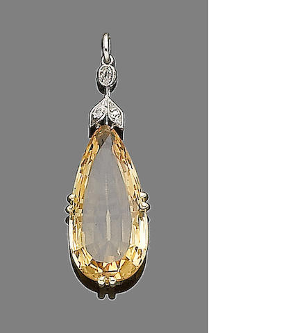 A topaz and diamond pendant necklace (partially illustrated)