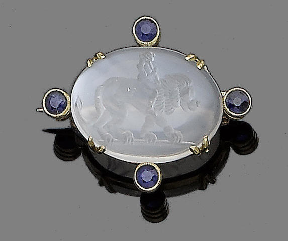 A moonstone intaglio and sapphire brooch