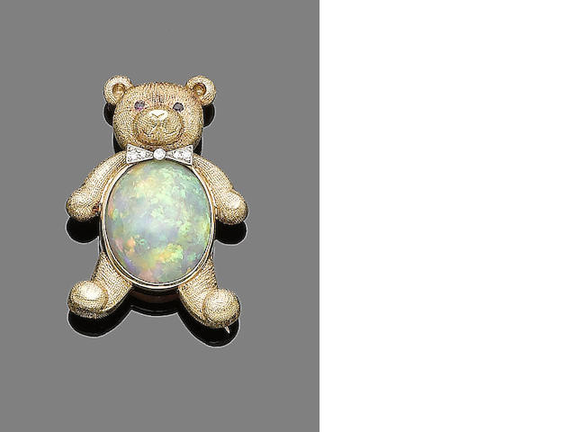 An opal, ruby and diamond brooch