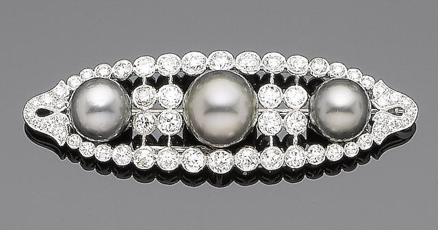A cultured pearl and diamond brooch