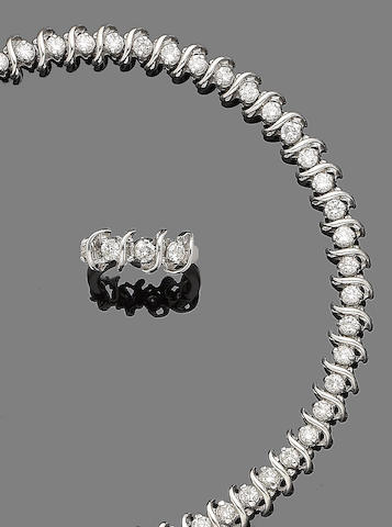A diamond line bracelet and ring suite (2)