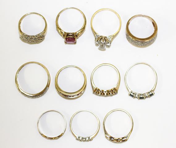 A collection of eleven variously set rings,