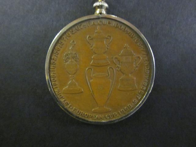 A Manchester United F.C. commemorative medal