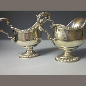 A matching pair of silver sauce boats, by Thos Bradbury and Son and the other by George Lambert Sheffield 1908, London 1898