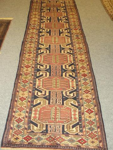 A Lenkoran runner and a shirvan rug plus another.