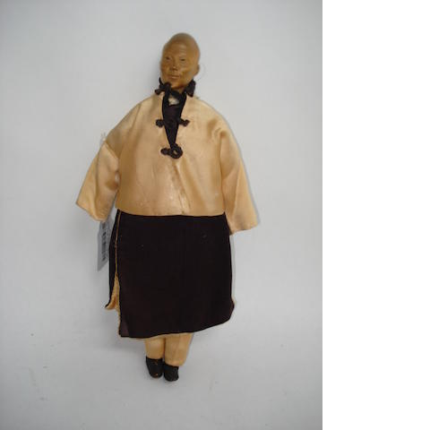 Door of Hope carved wooden Missionary doll