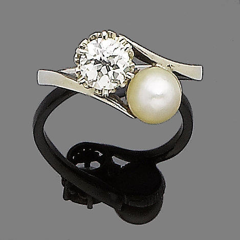 A pearl and diamond crossover ring