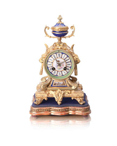 A 19th century gilt metal porcelain mounted mantel clock
