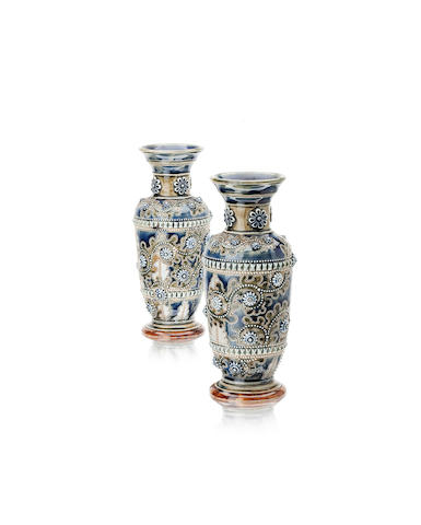 A pair of Doulton Lambeth stoneware vases by George Tinworth Dated 1876