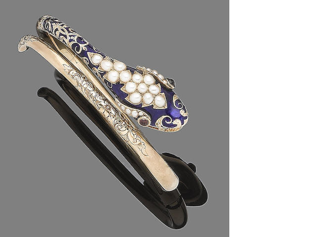 An enamel, seed pearl and garnet bangle,