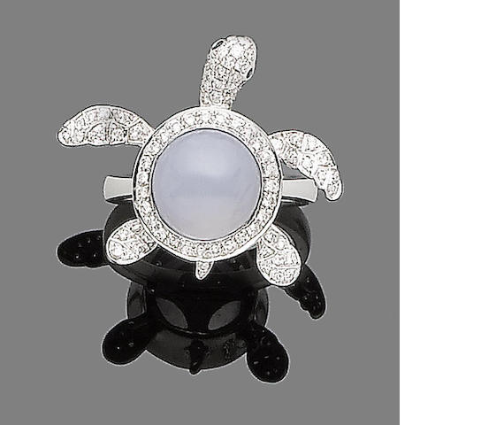 A chalcedony, sapphire and diamond ring
