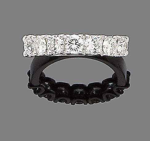 A diamond half-hoop ring