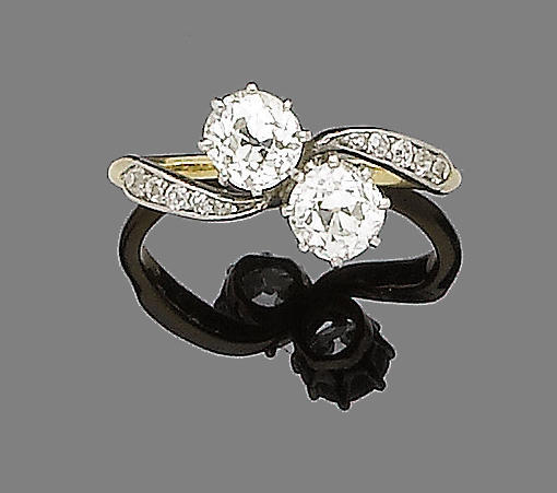 An early 20th century two-stone diamond crossover ring