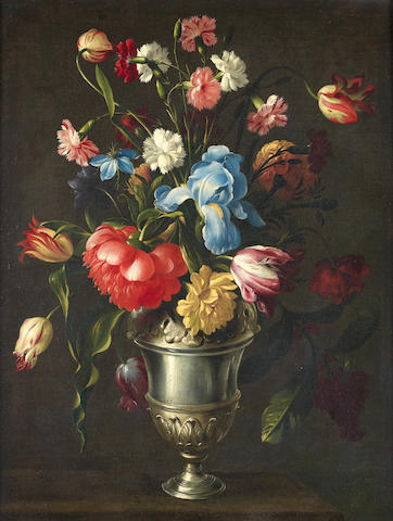 Giovanni Stanchi (Rome 1608-circa 1673) An iris, a peony, love-in-a-mist, tulips, pinks and other flowers in a silver urn