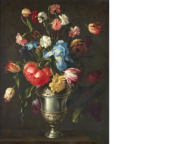 Circle of Giovanni Stanchi (Rome 1608-died after 1673) An iris, a peony, love-in-the-mist, tulips, pinks and other flowers in a silver vase