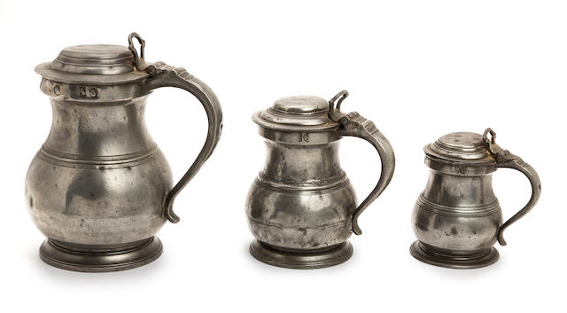 A rare set of three early 19th century pewter lidded bulbous measures Circa 1830-50, Birmingham