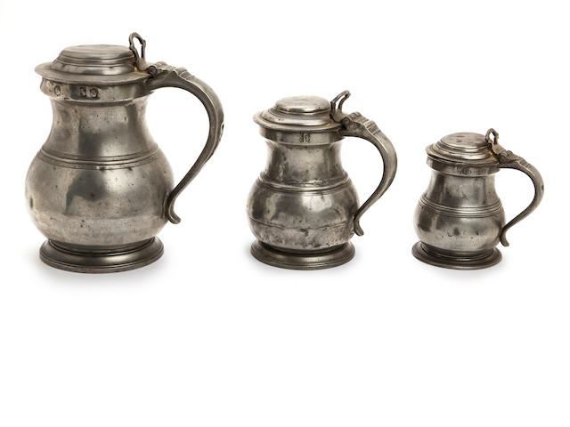 A set of three early 19th century pewter lidded bulbous measures Circa 1820