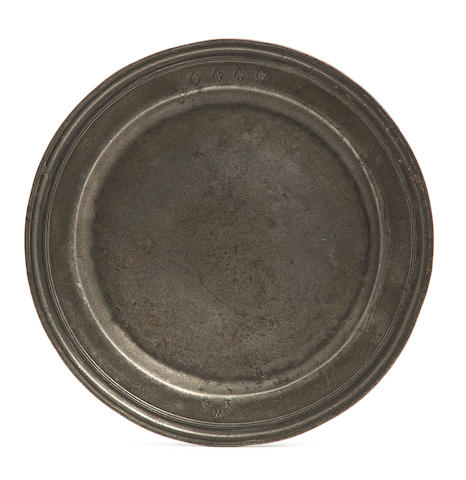 A late 17th century pewter triple reed plate  Circa 1690