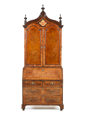 A George I walnut cross banded and featherbanded bureau cabinet circa 1720