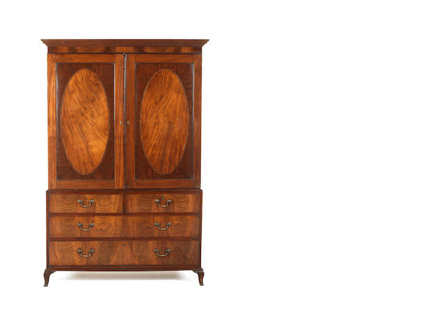 A George III mahogany and rosewood banded linen press