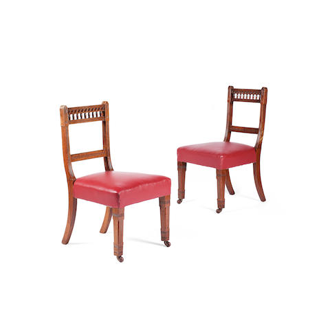 A set of eighteen Victorian oak dining chairs In the manner of Bruce Talbert