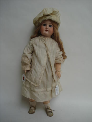 A.M Floradora bisque head doll