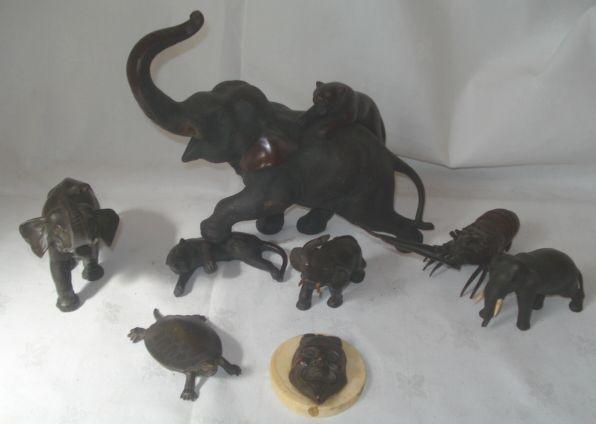 A Japanese patinated bronze model of a crayfish, 22cm, a patinated bronze Japanese mask on oval ivory base, a bronze model standing elephant, 9cm long, a elephant and tiger group (af), terrapin model, 12cm, and two bronzed pewter models of elephants.