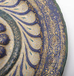 A rare Venetian enamel and parcel gilt decorated copper dish, circa 1500