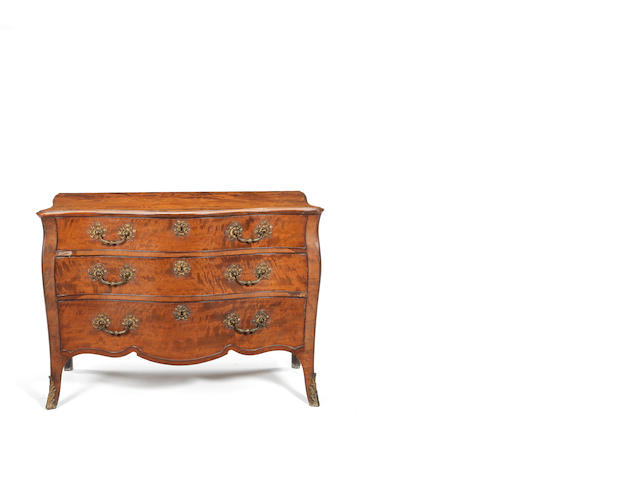 A George III sabicu, padouk and gilt-brass mounted serpentine commode attributed to John Cobb