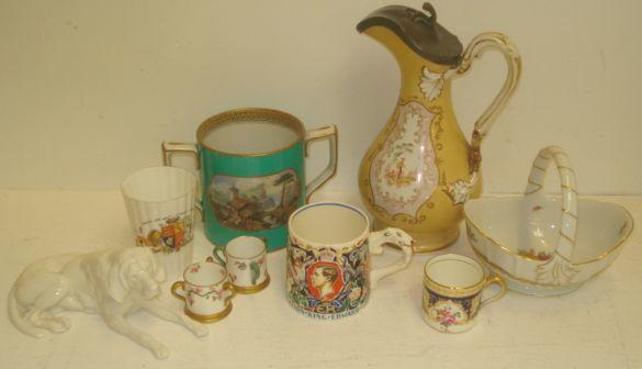 An Edward VIII Coronation mug, designed by Dame Laura Knight, Victorian Prattware two handled loving cup, printed with two views, No. 123, Victorian ewer published by James Dixon & Sons, two miniature Crown Staffordshire tygs, German blanc de chine figure of a bloodhound, Rosenthal basket and two other items. (9)