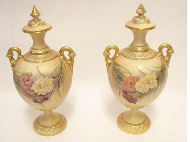 A pair of Royal Worcester vases and covers 1903