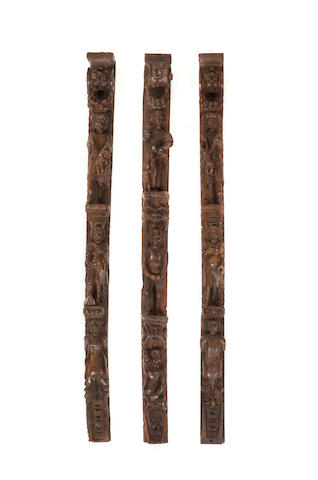 Three late 16th century carved walnut pilsaters or terms, Flemish or Italian