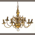 A 20th century brass eight-branch chandelier, in the Dutch 17th century manner, ensuite with the previous lotFitted for electricity