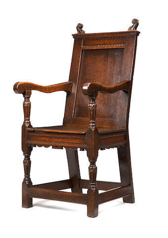 A rare and fine Elizabeth I oak panel back armchair Circa 1570-80
