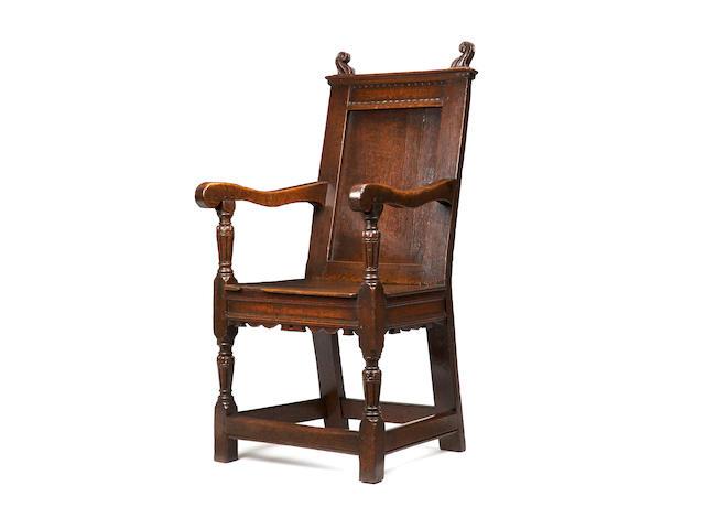 A rare and fine Elizabeth I oak panel back armchair Circa 1570-80
