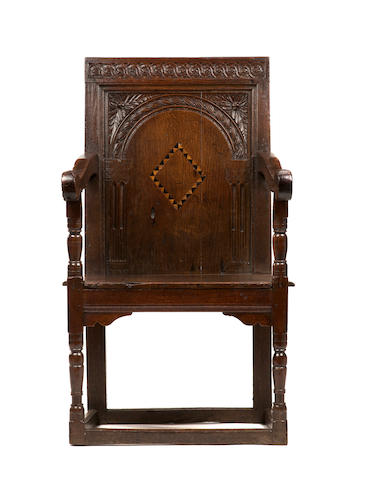 A rare Elizabeth I oak and inlaid panel back armchair Circa 1585-1600