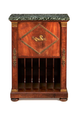 A French 19th century brass mounted mahogany music cabinetin the Empire style
