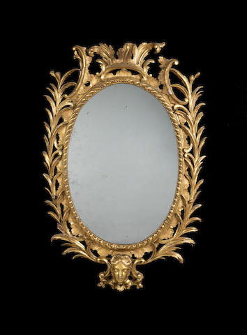 A George III carved giltwood mirror in the manner of Linnell