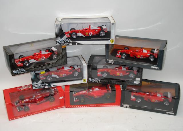 Eight Michael Schumacher Ferrari Formula 1 race car models,