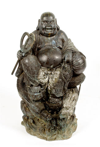 A 20th century large bronze model of a seated buddah