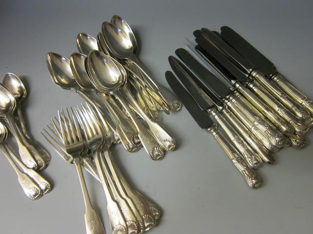 A composite canteen of George IV/William IV fiddle and shell pattern flatware and cutlery, mixed dates, London 1821, Dublin 1830, 1833