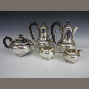 A silver five piece tea service,  London 1935, coffee pot and hot water jug unmarked stamped silver,    (5)