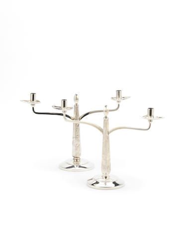 A matched pair of silver two-branch small candelabra one maker's mark T.S.C, London 1968, the other by Nayler Bros, with millennium mark 2000  (2)