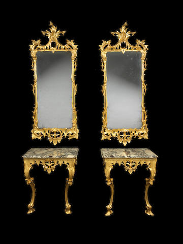 A pair of late George II carved giltwood console tables with pier mirrors en-suite