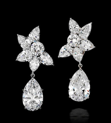 An importnat pair of diamond ear clips, by Harry Winston