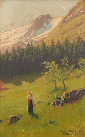 Hans Dahl (Norwegian, 1849-1937) Girl in a meadow with snow-capped mountains beyond