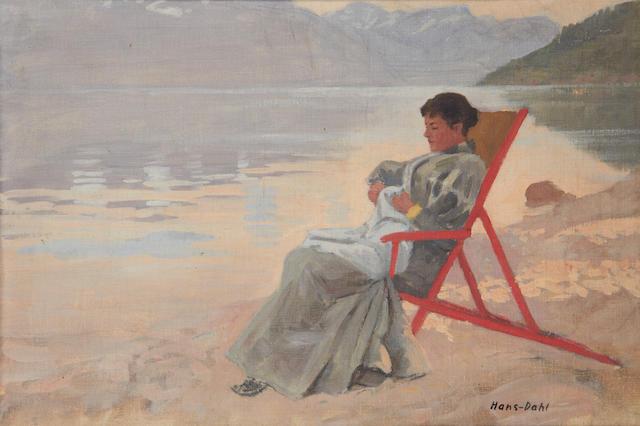Hans Dahl (Norwegian, 1849-1937) Woman in a deckchair at the water's edge